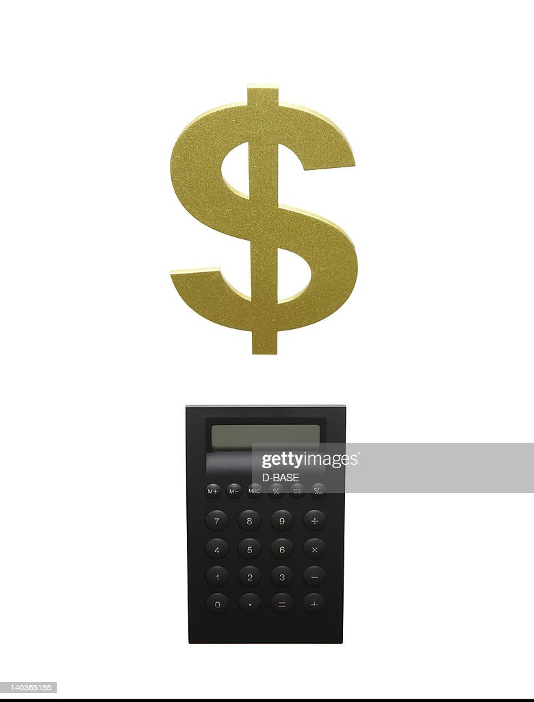 A black calculator and a dollar sign : Stock Photo