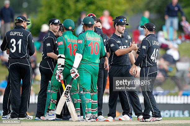 Black Caps players celebrate after the second One Day International match between New Zealand and New Zealand and Bangladesh at Saxton Field on...