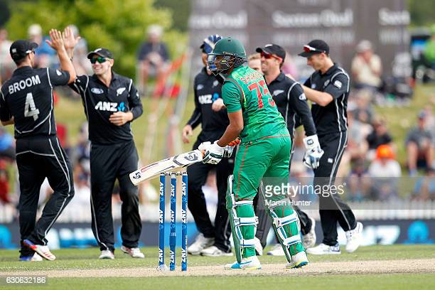 Black Caps players celebrate the wicket of Shakib Al Hasan of Bangladesh during the second One Day International match between New Zealand and New...