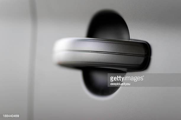 Black car doorhandle close up