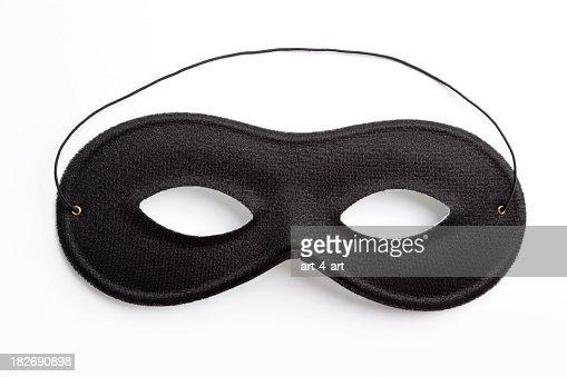 Black carnival mask on white background