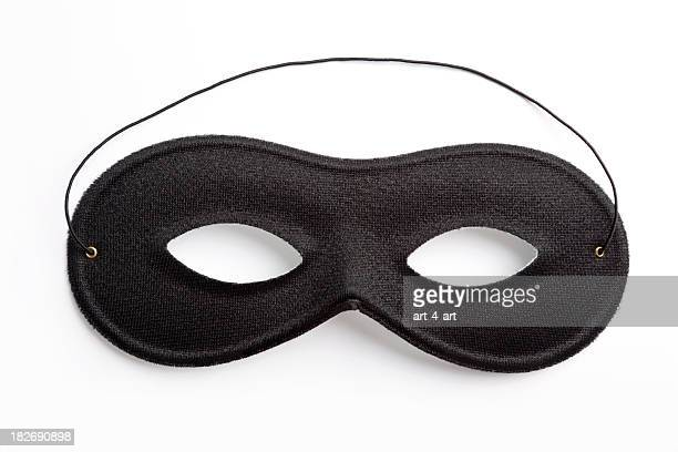 Black carnival mask on white background