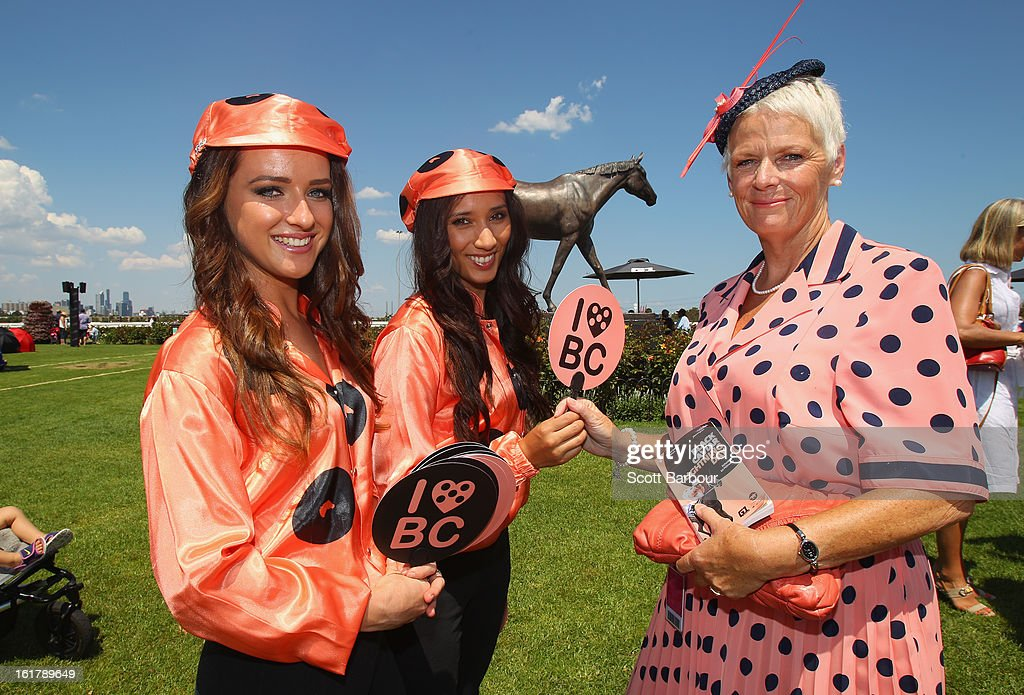 Black Caviar promotional girls hand out fans to a Black Caviar supporter during Lightning Stakes Day at Flemington Racecourse on February 16, 2013 in Melbourne, Australia.