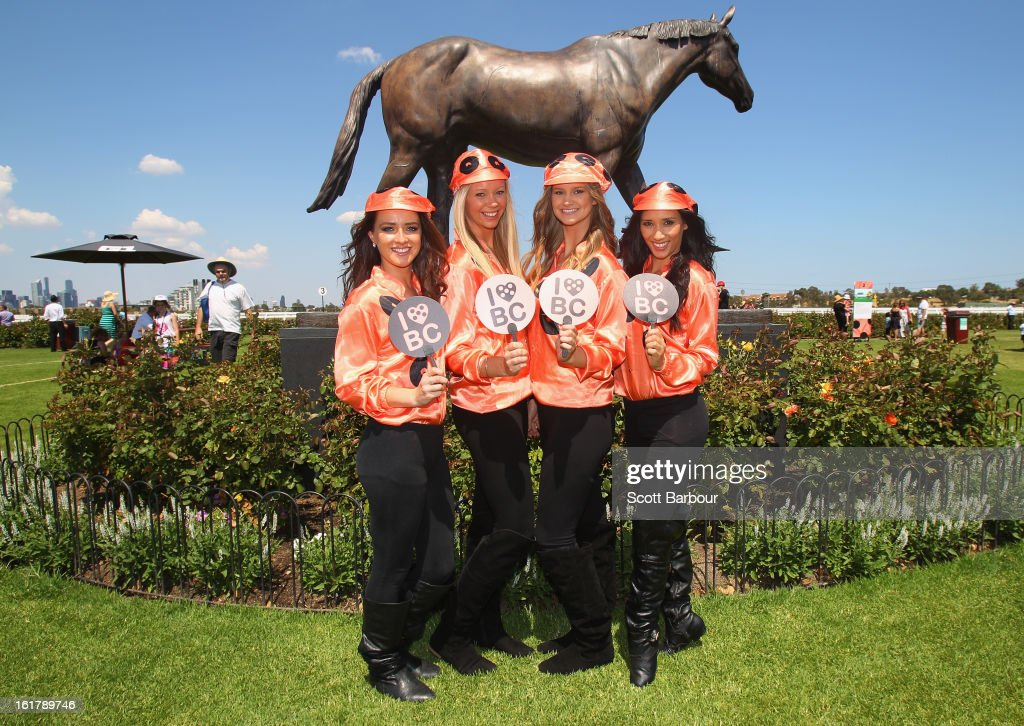 Black Caviar promotional girls show their support during Lightning Stakes Day at Flemington Racecourse on February 16, 2013 in Melbourne, Australia.