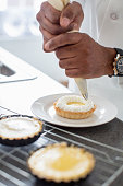 Black chef making key lime tart in restaurant