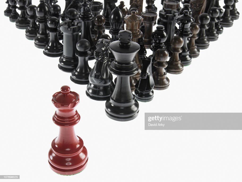 Black chess pieces with opposing queen
