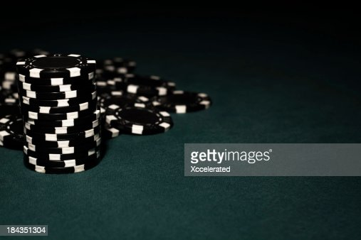 Black chips on Green Felt Poker Table