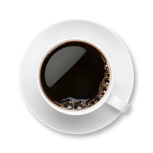 Black Coffee in a white cup and saucer with bubbles