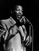 Black comedian Dick Gregory at the microphone 1962