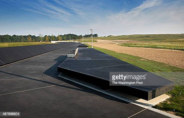 Black concrete makes up the memorial plaza designed to evoke an airplane wing at the Flight 93 September 11 memorial on August 2011 in Shanksville PA
