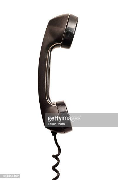 A black corded telephone mouth and earpiece