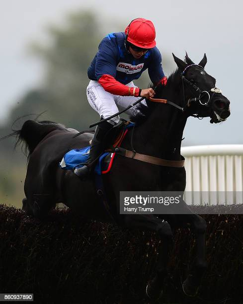 Black Corton ridden by Bryony Frost jump the last on their way to victory in the Weatherbys Racing Bank Intermediate Chase at Newton Abbot Racecourse...