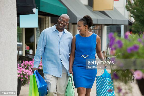 Black couple carrying shopping bags
