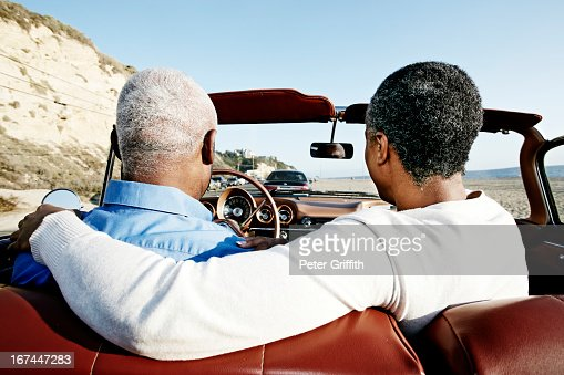 Black couple driving convertible : Stock Photo
