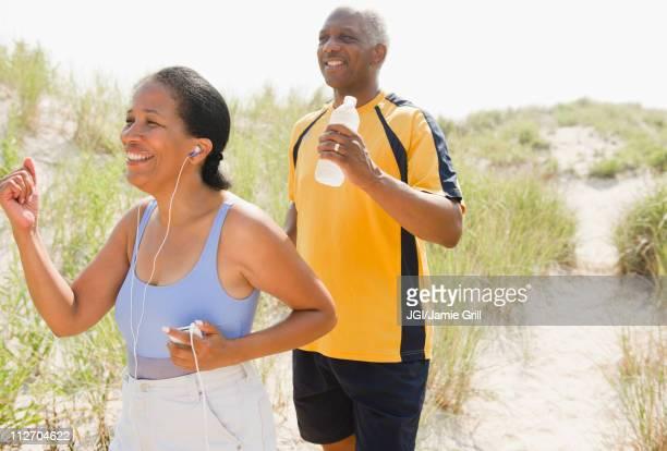 Black couple exercising on beach