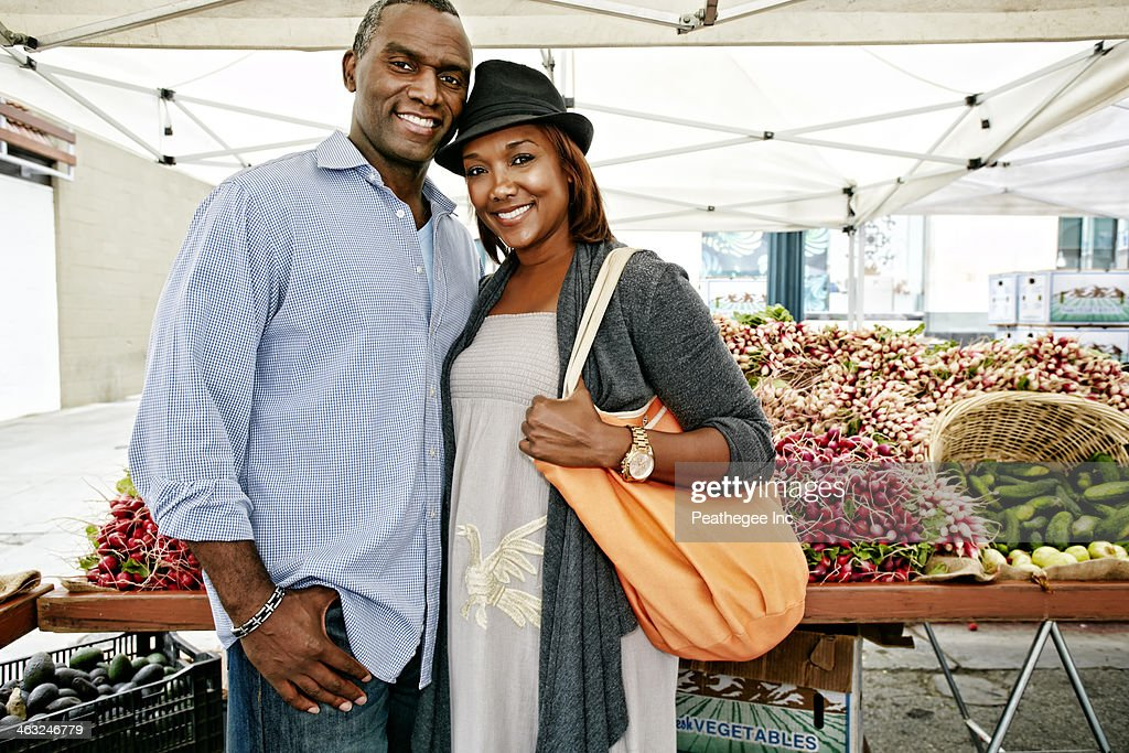 Black couple shopping at outdoor market : Stock Photo