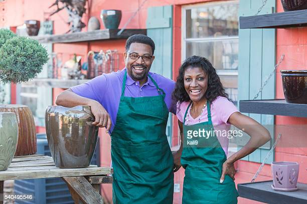 Black couple working in plant nursery
