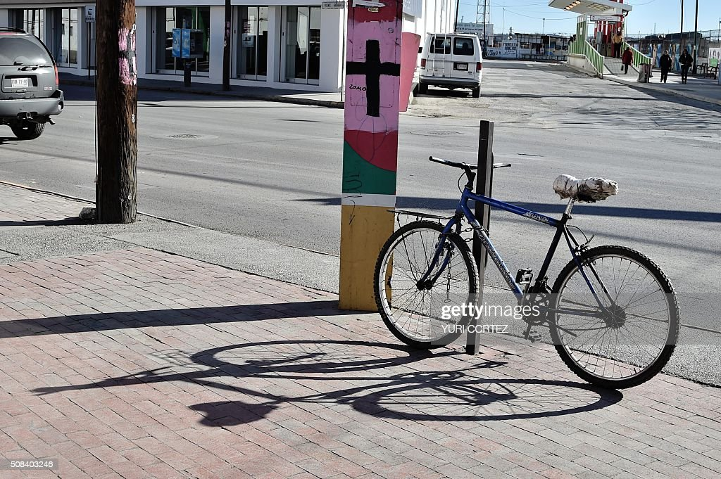 Black crosses on pink backgrounds were painted on light posts in memory of missing girls in Ciudad Juarez Mexico on February 3 2016 Hundreds of...