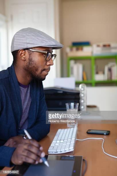 Black designer working at desk