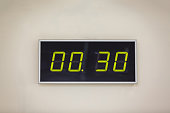 Black digital clock on a white background showing time 0 hours 30 minutes