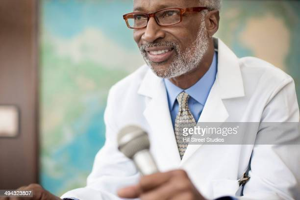 Black doctor giving presentation
