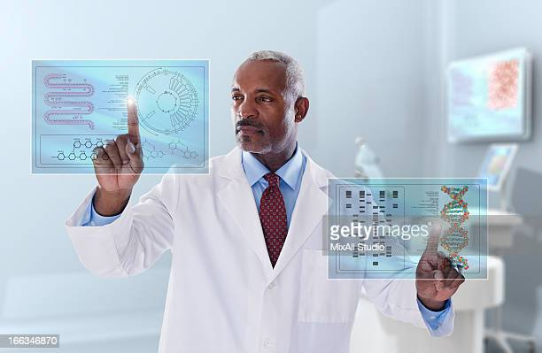 Black doctor looking at digital display in laboratory