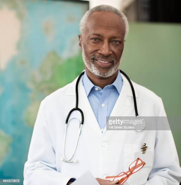 Black doctor smiling in office
