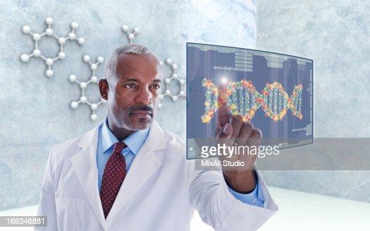 Black doctor using digital display : Stock Photo