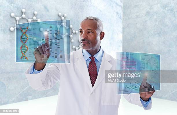 Black doctor using digital display