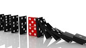 Black domino tiles in a row about to fall with red one standing on the way, on white