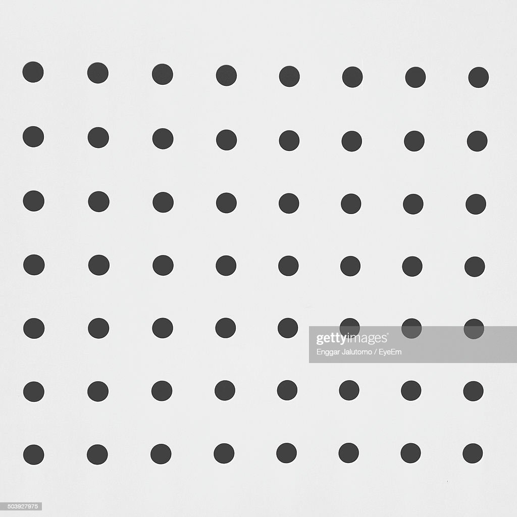 Black dots against white background