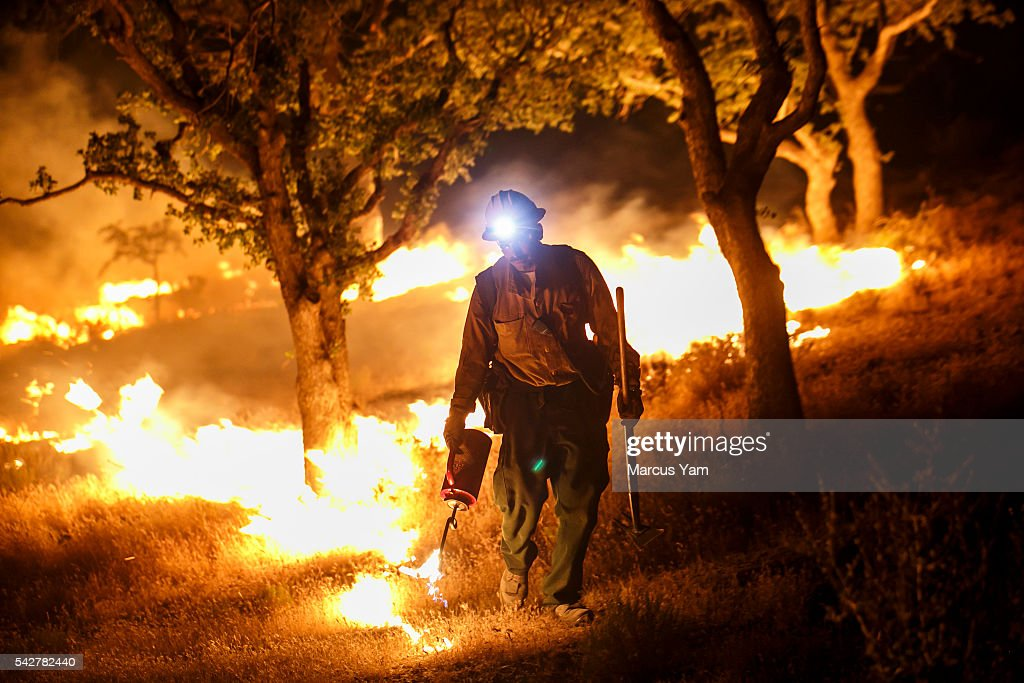 Black Eagles fire crew, from Porterville, perform a firing operation in Lake Isabella, Calif., on June 24, 2016.