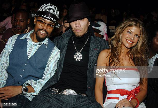 Black Eyed Peas during Olympus Fashion Week Spring 2005 Tommy Hilfiger Front Row at Theater Tent Bryant Park in New York City New York United States