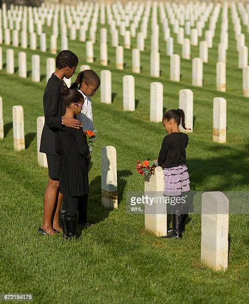 Black family at military cemetery