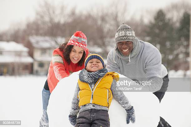 Black family playing in snow