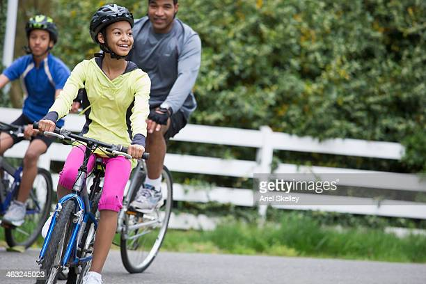 Black family riding bicycles together
