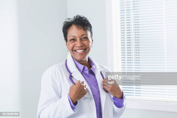 Black female doctor in lab coat