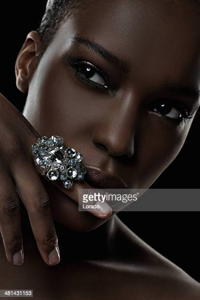 black female model wearing luxury ring