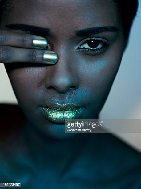black females face with two fingers covering eye