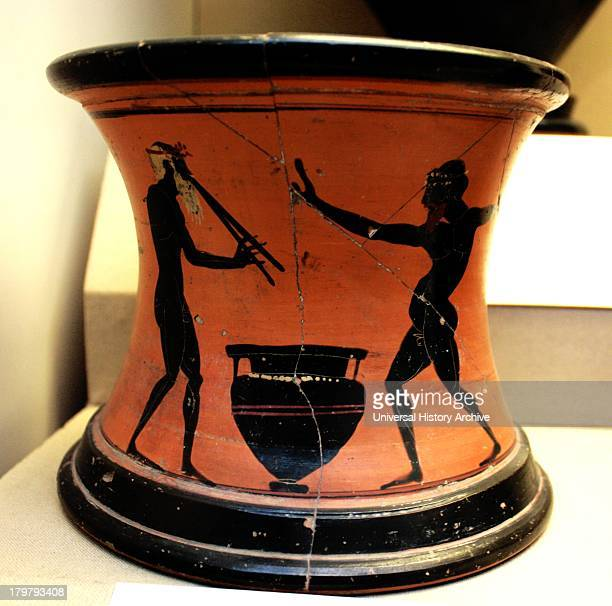 Black figured stand showing revelers Greek made in Athens around 520500 BC Said to be from Vulci Italy Stands like this were used to support pointed...