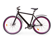 Black fixed simple urban bike with violet whells. Isolated on white, clipping path included