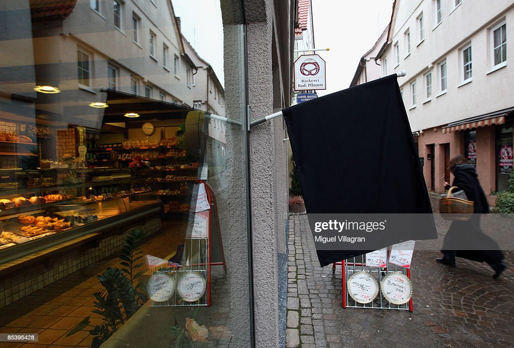 A black flag is seen in front of a store on March 12 2009 in Winnenden near Stuttgart Germany 17 year old Tim Kretschmer opened fire yesterday on...