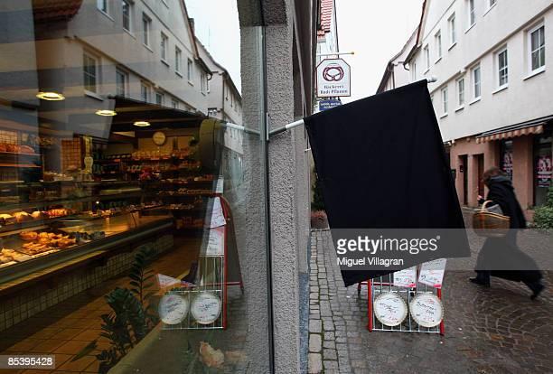 A black flag is seen in front of a store on March 12 2009 in Winnenden near Stuttgart Germany 17 year old Tim Kretschmer opened fire yesterday on...