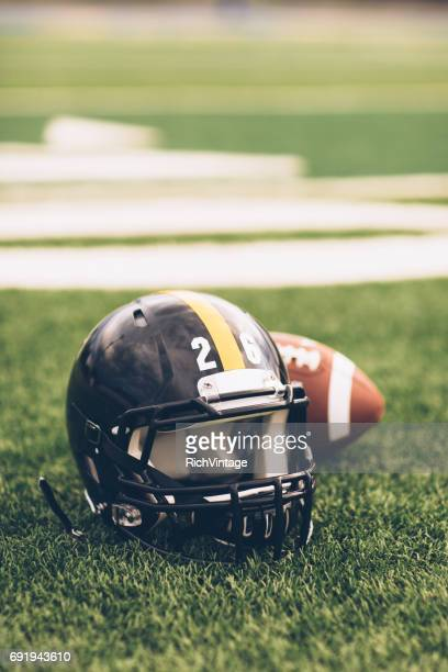Black Football Helmet on Field