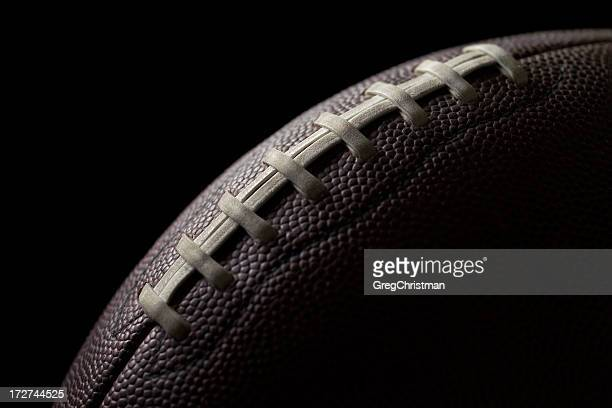 Black football on a black background