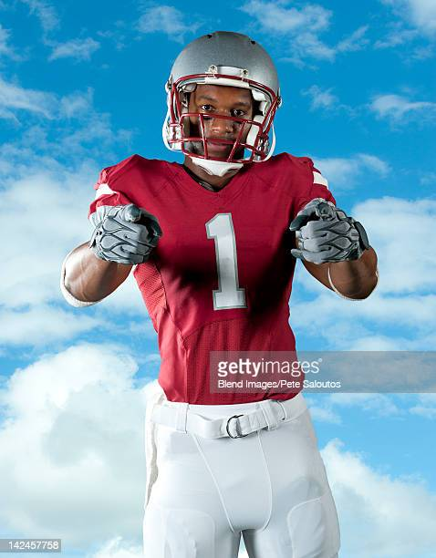 Black football player pointing
