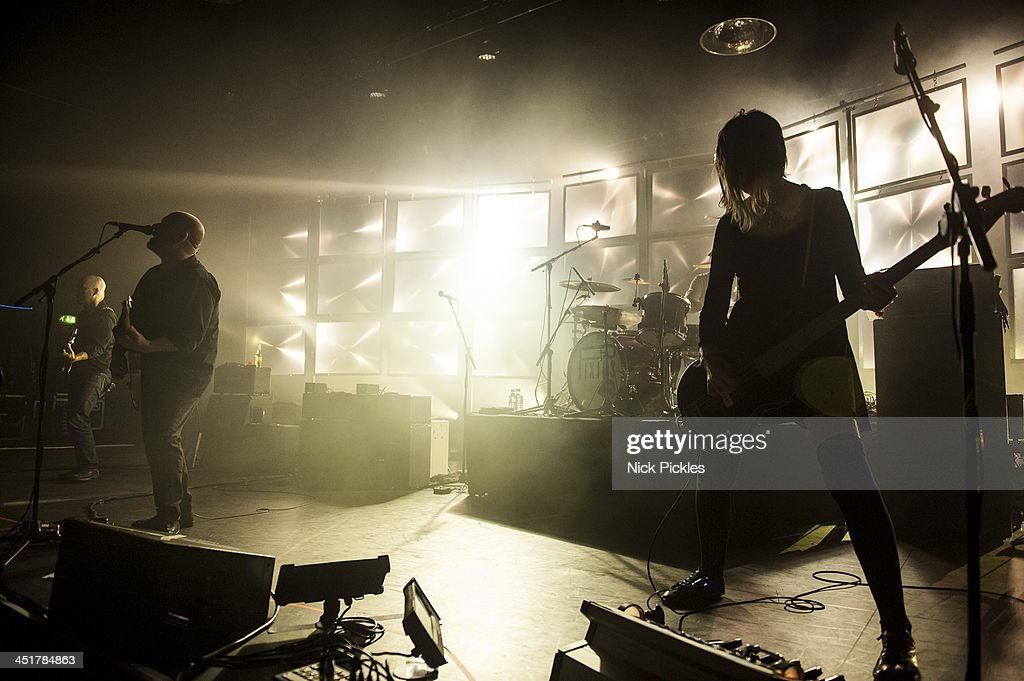 Black Francis and Kim Shattuck of Pixies perform on stage at Hammersmith Apollo on November 24 2013 in London England