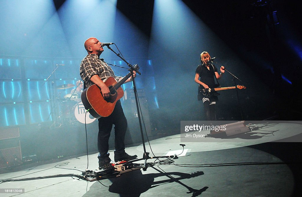 Black Francis and <a gi-track='captionPersonalityLinkClicked' href=/galleries/search?phrase=Kim+Shattuck&family=editorial&specificpeople=4687167 ng-click='$event.stopPropagation()'>Kim Shattuck</a> of The Pixies perform live on stage on Day 25 of iTunes Festival 2013 at The Roundhouse on September 25, 2013 in London, England.