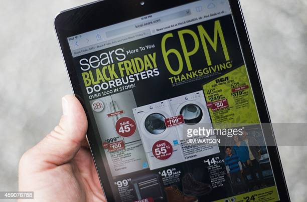 A 'Black Friday' advertisement for Sears is seen on an iPad in Annapolis Maryland November 16 2014 'Black Friday' is coming early this year to...