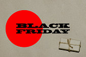 Black friday hot sale.  The inscription is black Friday on craft paper with a bright red insert with a gift, a place for text advertising and banner.